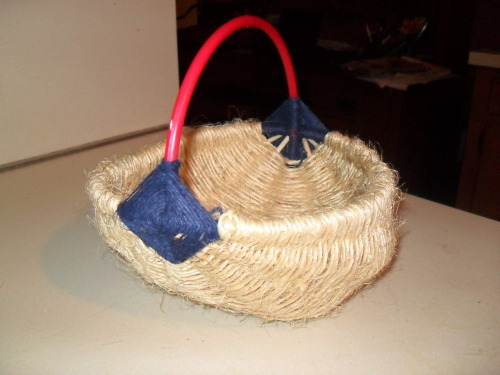 8 inch egg basket made out of plastic rings from broken Xmas deco, used bamboo skewers for the ribs, bleu hemp leftover from jewelry making, and scrap jute twine and some more off the roll when that ran out. First basket I ever wove!!
