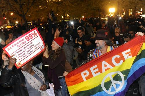 inothernews:  REPEAT PERFORMANCE   Occupy Wall Street  demonstrators flood back into Zuccotti Park after police open the  barricades and began letting people back in Tuesday evening. (Photo: Aaron Showalter / New York Daily News)