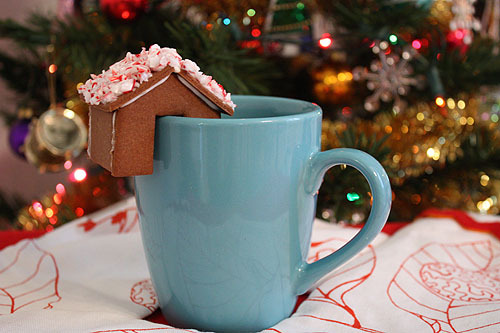 a tiny gingerbread house that perches on the edge of your mug : not martha Gingerbread house storage.