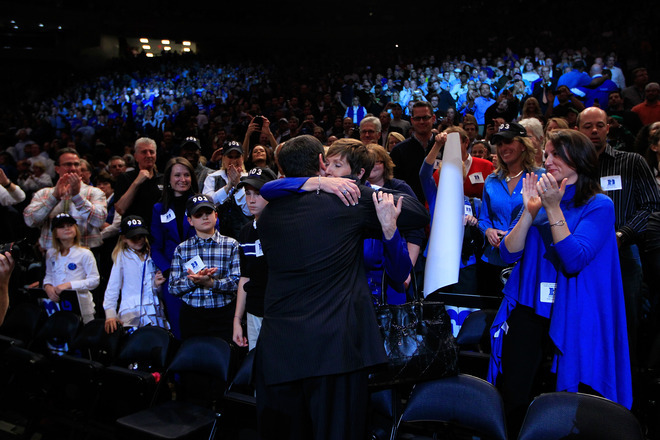 Head coach Mike Krzyzewski of the Duke Blue Devils hugs his wife Mickie after winning his 903rd NCAA Division 1 basketball game and becoming the winningest coach in history. Duke defeated the Michigan State Spartans during the 2011 State Farms Champions Classic at Madison Square Garden on November 15, 2011 in New York City. (Photo by Chris Trotman) (via Yahoo! Sports Photos)