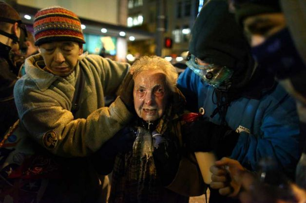 From Seattle PI: Seattle activist Dorli Rainey, 84, reacts after being hit with pepper spray during an Occupy Seattle protest on Tuesday, November 15, 2011 at Westlake Park. Protesters gathered in the intersection of 5th Avenue and Pine Street after marching from their camp at Seattle Central Community College in support of Occupy Wall Street. Many refused to move from the intersection after being ordered by police. Police then began spraying pepper spray into the gathered crowd hitting dozens of people. A pregnant woman was taken from the melee in an ambulance after being struck with spray. Photo: JOSHUA TRUJILLO / SEATTLEPI.COM