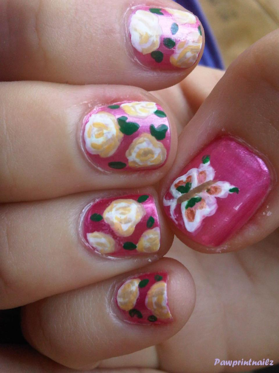 Short squoval; Bubblegum pink base, with white roses, and color coordinating butterfly on thumb. Materials: Ulta's Pink (unknown name, sorry), Craft Smart paint, small paintbrush, and Sally Hansen Diamond Top Coat. These were done for my best friend on her prom, a few months ago. Her dress was a cute soft pink, so she picked a lively bubblegum pink as her back round color. It was her polish, so I don't have the name to post up on here, but I believe she got it at Ulta from the Ulta brand. She wanted white roses to go with the the soft theme of her outfit. Let me tell you right now, white roses are much difficult than they seem, haha. We joked that the roses ended up looking like popcorn, lol! She still liked it though, as a good friend would. :)