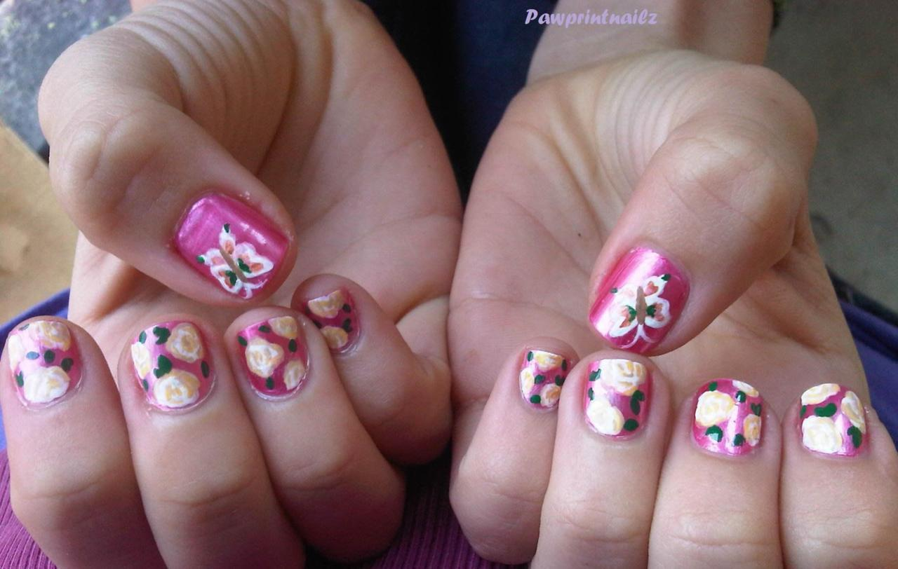 Short squoval; Bubblegum pink base, with white roses, and matching butterfly on thumb. Materials: Ulta's Pink (unknown name, sorry), Craft Smart paint, small paintbrush, and Sally Hansen Diamond Top Coat.