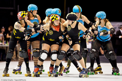 20111111.WFTDA1_0048 by Axle Adams on Flickr.Rosie the Rioter, ThoroughBled and Dolly Rocket work to hold the front