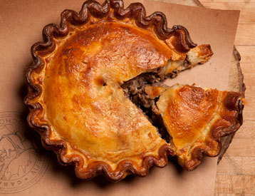 coelasquid:  Canada's Lusty Meat Pie - Tourtiere (From Men's Journal) Things like this are why it bugs me when people act like Canada has no cuisine. Those folks need to hit up a Festival du Voyageur someday.