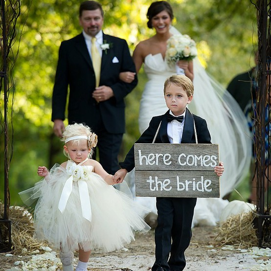 I love the idea of the ring bearer holding a sign, because he really doesn't bring the ring with him, the best man does. Photography: Jason Crater Photography