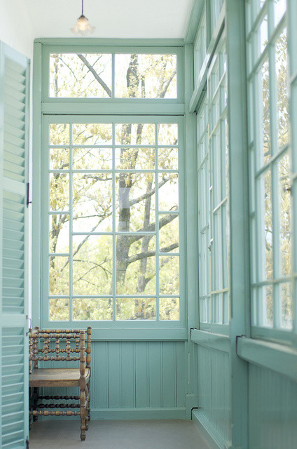 A lovely enclosed porch surrounded by transom windows, with woodwork painted a soft and minty turquoise hue (via Untitled | Flickr - Photo Sharing!)