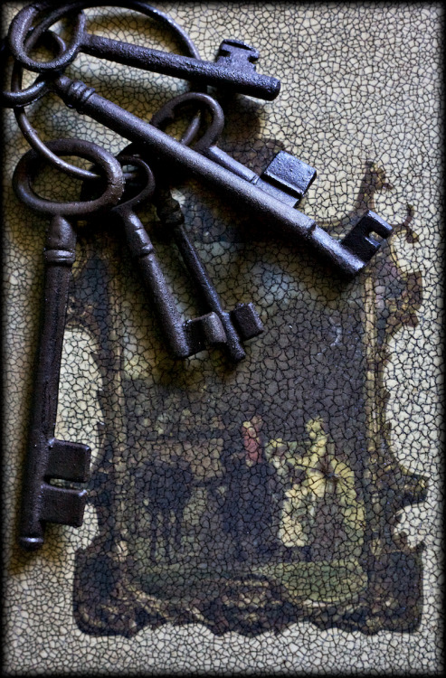 Keys and faded book cover.