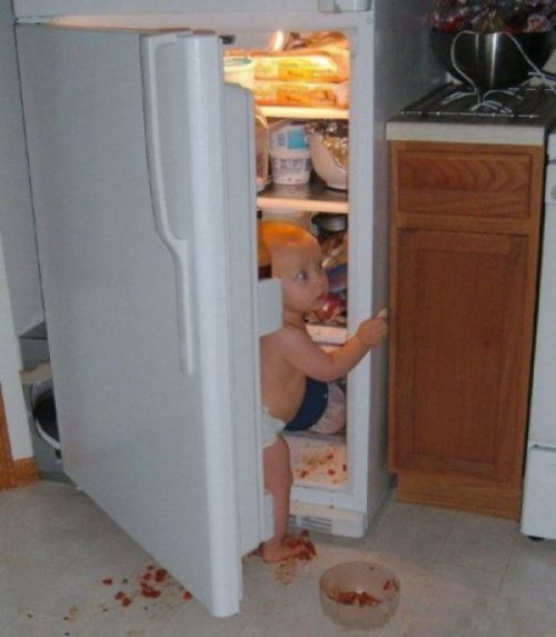 Baby Raids Fridge   Until they start making pizza-flavored baby food, expect this often.