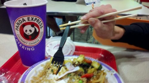 How To Use Chopsticks   That's actually a prosthetic arm he's maneuvering with his actual foot.