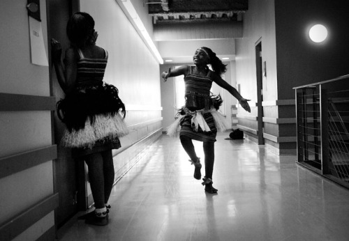 A Ugandan girl from a dance troupe rehearsing before her performance.  © Doug Menuez