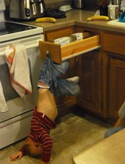 Kid Stuck On Kitchen Drawer   His parents were kind enough unhook him. 3 days later.