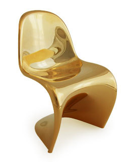 Mini Treat Limited Edition gold Panton miniature chair - only 500 pieces made to celebrate the opening of the Panton Chair exhibition at the Tokyo Opera City Art Gallery in 2009. (via chairblog.eu)