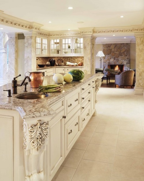 This beautiful, custom-designed kitchen displays carved accents on the large kitchen island, as well as carved crown molding. (via Donna Venegas - traditional - kitchen - boston - by Venegas and Company)