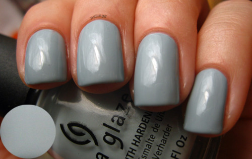 china glaze - sea spray i could not for the freaking life of me get an accurate photo of the pearly shimmer in this polish. it's invisible in this photo :(. sea spray is so soft and pretty. i got a lot of compliments on this for some reason!