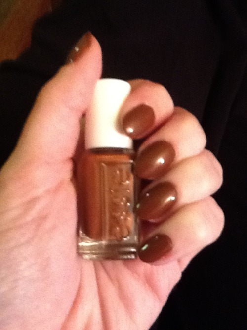 This color* is hideous. I blame Erin.  She suggested I ease into fall with this deceivingly pumpkin-pie-colored-polish-in-the-bottle when in real life the color is more akin to brown.  Regular brown.  Brown brown.  BOR-ing brown. But alas, I'm too lazy to change the polish right now.  Guess I'll learn to live with it. *Actual color (essie's 'Very Structured' from the fall 2011 collection) may not be actually hideous and may, in fact, just be actually hideous on my hands only.  However, I still blame Erin.