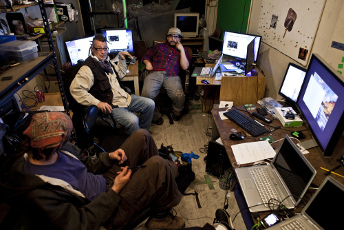 "laughingsquid:  Inside Occupy Wall Street's (Kinda) Secret Media HQ  Note the keyboard sitting on top of the laptop. Janky, but you know what, kinda awesome. When did this secret media lair start, anyway? About a month ago. ""We moved most of this equipment the day before the police raid,"" said Spike, the bandana-clad guy on the left (who we imagine is named after an Elvis Costello album, but actually isn't). That police raid took place back on October 14, almost exactly a month before this week's raid."