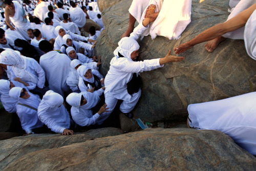 Muslim pilgrims climb a rocky hill called the Mountain of Mercy, on the Plain of Arafat near Mecca, Saudi Arabia,on November 5, 2011. (AP Photo/Hassan Ammar) (via The Hajj and Eid al-Adha 2011 - Alan Taylor - In Focus - The Atlantic)