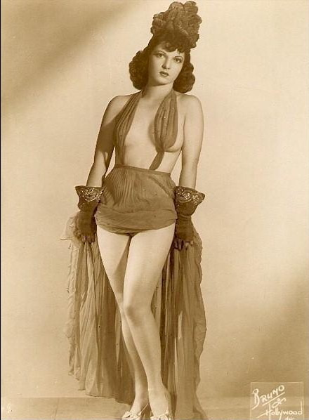 nofrillsretro:  The undisputed Queen of the Old Howard's Burlesque era was Ann Corio, who starred here in the 1920s and 1930s.  Ann would later appear in several motion pictures, write a best-selling book (This Was Burlesque,) a musical (also titled This Was Burlesque,) and even have a hit record (How to Strip for Your Husband.)  But her real fame came from her days performing for Harvard students (and their professors,) mayors, high school truants, businessmen - and their wives - on the stage of the Old Howard.