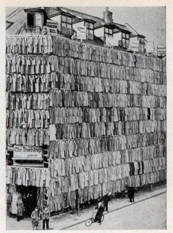Date unknown Overstocked with a large supply of men's spring and winter coats, a  clothier in Copenhagen, Denmark, adopted a unique sales scheme. He  erected a scaffolding around his store building and completely covered  it from roof to sidewalk with more than a thousand overcoats. The novel  display attracted prospective customers in such droves that police were  summoned. Although the police ordered the proprietor to remove the  display, he succeeded in selling all the overcoats.