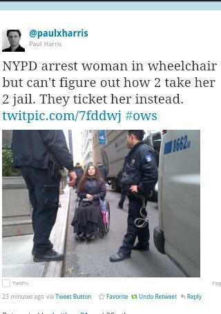 (Photo) NYPD arrest woman in wheelchair at Occupy Wall Street protest, but can't figure out how to take her to jail. They give her a ticket instead. (11/17/11)