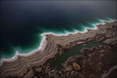 The water levels in the Dead Sea  – the deepest point on Earth – are dropping at an alarming rate with  serious environmental consequences, according to Shahrazad Abu Ghazleh  and colleagues from the University of Technology in Darmstadt, Germany.  These amazing photographs were shot by Menahem Kahana, famous israelian photographer. More.  Ahhhh, what?