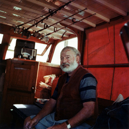 "brokenpintglass:  oldsparky:  Hemingway, 1950.  ""I didn't want to kiss you goodbye — that was the trouble — I wanted to kiss you goodnight. And there's a lot of difference.""—	 Ernest Hemingway  I know that there are SOME PEOPLE that don't really care for Hemingway, but I'm not one of them."