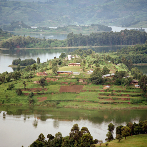 The sun highlighting one of the many islands on Lake Bunyonyi. © Dillon Marsh