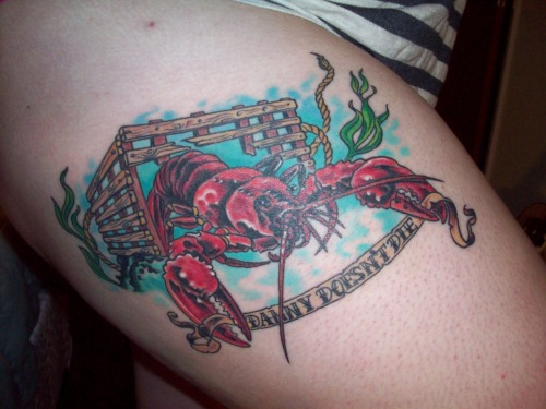 "fuckyeahtattoos:  This is Mr. Inky, the lobster that lives on my right thigh. This is my second of two memorial tattoos (the first being a sea turtle on my back) and most recent of my four tattoos total. I got the lobster in memory of one of my best friends who died in a traffic collision at age 21. She had a sort of weird obsession and fascination with lobsters. The banner says ""Danny Doesn't Die,"" which is a reference to (/kind of a spoiler of) the movie Hot Fuzz. The first time we watched that movie together, she started crying at the end because she thought one of the main characters was dead. We had to pause the movie to assure her that Danny does not, in fact, die. I miss my friend every day, but this tattoo has definitely helped me heal and it fills me with fond memories whenever I look at it. The tattoo was done in two sittings, about 7 hours total, by Dan at Primal Decor in Eureka, CA. The tattoo is his design and when he sent me the sketch after our consultation, I almost cried because it was almost exactly what I had pictured in my mind. I've been tattooed by him twice now and I'm honestly pretty nervous about the prospect of being tattooed by anyone else.  Почти как рак"