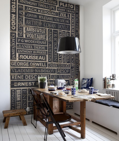 Dining or breakfast nook with terrific typography wall art of the names of great authors (via Style Sourcelist: Create this Look in Your Dining Room | Apartment Therapy Los Angeles)