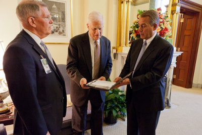 House Speaker John Boehner presents James Billington, Librarian of Congress, with items for the Veterans History Project from his district in Ohio on Wednesday at the Capitol. Bob Patrick, director of the Veterans History Project, is at left. (Official photo from the SpeakerBoehner Flickr stream)