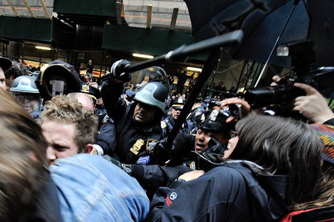 Bag's Take-Away:  If there's an iconic shot from today's OWS face off, it's the kinetic one of NYPD's long sticks. (Kinetic meaning, in use.)  From City Room: Protesters and Officers Clash Near Wall Street and in Zuccotti Park  (photo: Robt Stolarik/NY Times caption: Officers with batons moved on the crowd on Beaver Street near Broad Street.) ————— Topping LIFE.com's 2011 list of Best Photo Blogs, follow us at: BagNewsNotes; BAG Twitter; BAG Facebook; Bag by Email.