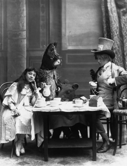 "theconstantbuzz:  The Mad Hatter's Tea Party from ""Alice in Wonderland"" with Rosa Hersee as Alice and Arthur Elliot as the Hatter at the Opera Comique Theatre in London,  1898. © London Stereoscopic Company."