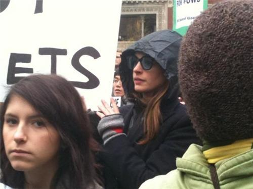 "inothernews:  (Photo of actress Anne Hathaway at the Occupy Wall Street protest in Union Square earlier today holding a sign that reads ""Blackboards Not Bullets"" by @elana_brooklyn via the New York Daily News)"