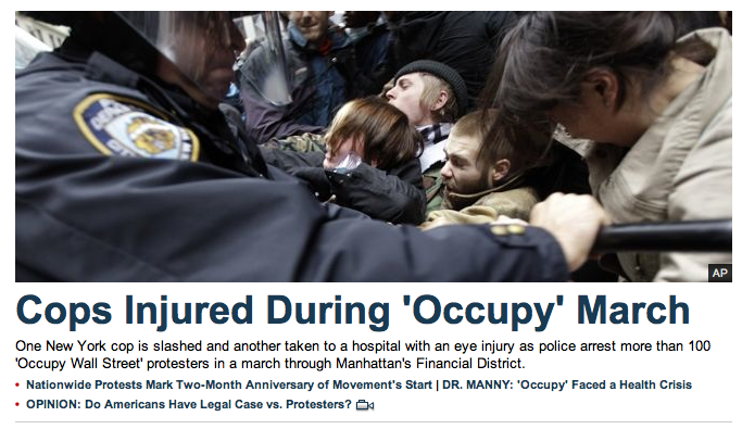 reallyfoxnews:  Scores of protestors two cops injured at the Occupy Protests, Fox News front page.  *eyeroll* If you are going to spin reality, at least find a photo of a cop petting a kitten.