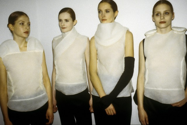cotonblanc:   Models in structured, sheer white tops backstage at the Helmut Lang Fall/Winter 1999 show.  fall–winter 1999–2000, helmut langphotography kyle ericksen