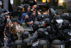 ybot:   Today at Occupy Portland: Protester hit with pepper spray at point blank range.  Look at all the immediate threat to herself and others she is posing by standing there saying a thing. Good thing they got her, she might have said more things!