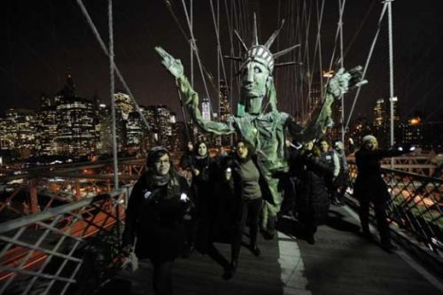 "wespeakfortheearth:  Is The #Occupy Movement Only Getting Stronger? Short answer: Looks like it.  Two days after their dramatic eviction from Zuccotti Park, Occupy Wall Street roared back to life Thursday with colossal force on its citywide ""Day of Action,"" leading to mass arrests and violent clashes with an overwhelming police presence. At least 242 protesters were collared by the end of the day, and at least seven NYPD officers were hospitalized with injuries as thousands of protesters marched throughout lower Manhattan, the NYPD told amNewYork. At least five protesters were charged with felony assault. ""This is a 100% success. Everybody in the world has heard us today,"" said Anup Desai, a press liaison for Occupy Wall Street. ""The entire world is listening now, and we're only going to get bigger. This is only the beginning of many, many more movements."" Confrontations with police quickly turned violent after protesters tried returning to a barricaded Zuccotti Park following an early morning protest on Wall Street.  (via amNewYork)"