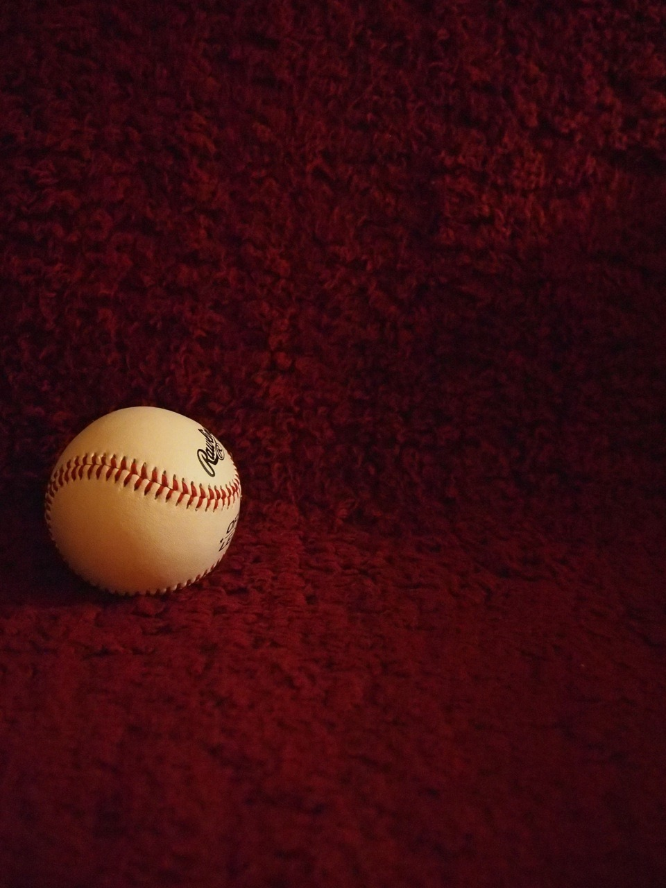 Space Composition: I took a picture of a baseball on my sofa. I left a lot of space on the right, so it will lead your eyes to the baseball on the left. Contrast: This photo has a big contrast with the darks and lights. The baseball has a sharp color(white) while the background has a dark color(dark red). Also, the baseball has two tones, half of it is darker than the other half, so once again it will catch your attention. Communications: This photograph communicates lonely and isolation. The baseball is staying alone in the corner.