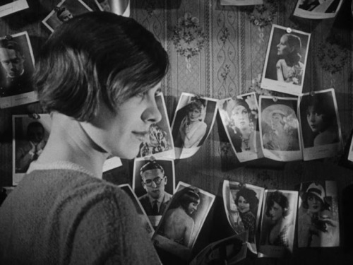 "Annie Schreyer gazes at photos of movie stars of the era……Menschen Am Sonntag (1929) aka ""People On Sunday"" The film is subtitled ""a film without actors"" and was filmed over a  succession of Sundays in Berlin in the summer of 1929. The actors were amateurs  whose day jobs were those that they portrayed in the film. They  were part of a collective of young Berliners who wrote and produced the  film themselves, on a shoestring budget."