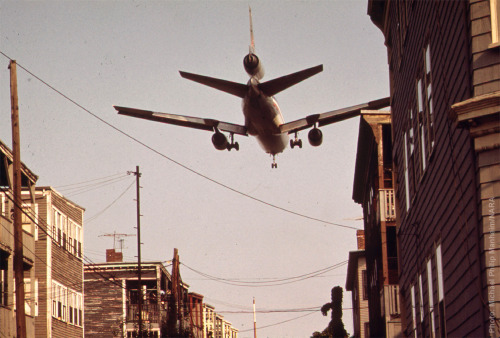 Near Boston's Logan Airport, an airplane comes in for a landing over homes on Neptune Road in May of 1973. Photo: Michael Philip Manheim/NARA