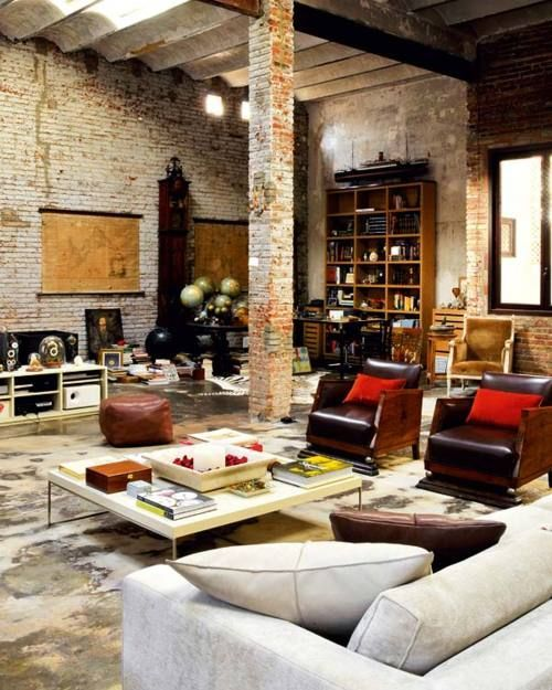 Modern furnishings are a great fit inside this industrial brick-walled loft apartment. (via little blue deer: Loft Lust)