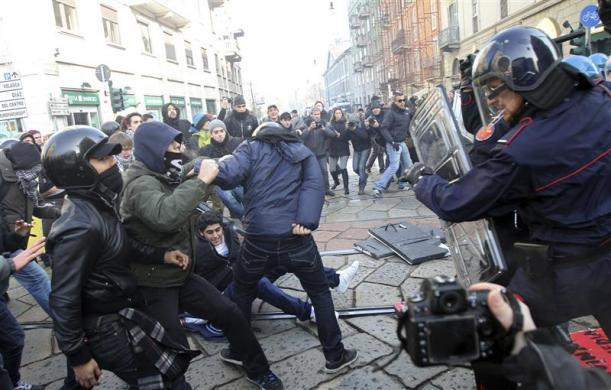 Milan, Italy Carabinieri paramilitary police clash with demonstrators during a protest (via Reuters.com)