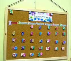 created my own perpetual calendar…cork board and scrapbooking materials will do the magic..=D