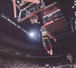"siphotos:  Seattle rookie Shawn Kemp goes airborne during the 1990 Slam Dunk Contest in Miami. Despite being one of the top dunkers of his time, the ""Reign Man"" never won any of the four Slam Dunk Contests he participated in.(Walter Iooss Jr./SI) SI VAULT: Kemp may be just 19, but he has potential to be a star (11.27.89)"