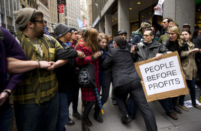 Who is this guy pushing his way through Occupy Wall Street? Here are your collected stories:  A personification of the American dream An adult grappling with the shame of having been an inept high-school running back A character in a Bret Easton Ellis book A player in a very serious game A Long Island-bred preppie A policeman-turned-security guard Just some guy who really has to crap