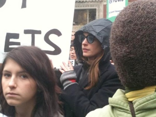 "occupyallstreets:  Anne Hathaway Joins Large Occupy Wall Street Crowd At Union Square Anne Hathaway took time off of her new film, The Dark Knight Rises, to protest with the 99%. She held a sign that said ""Blackboards Not Bullets."" On the back is ""Never Trust Millionaires—especially Italian ones.""  In 2008 Anne Hathaway broke up with her disgraced boyfriend after learning he was being charged with check fraud. Soon after he was charged again wire fraud and money laundering.  Source"