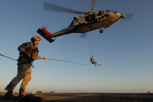 Image description: Sailors rappel from an MH-60S Sea Hawk helicopter during a training exercise aboard the guided-missile cruiser USS Gettysburg. HSC-9 and Gettysburg are conducting maritime security operations and support missions as part of operations Enduring Freedom and New Dawn. Photo by Mass Communication Specialist 3rd Class Betsy Knapper, U.S.Navy
