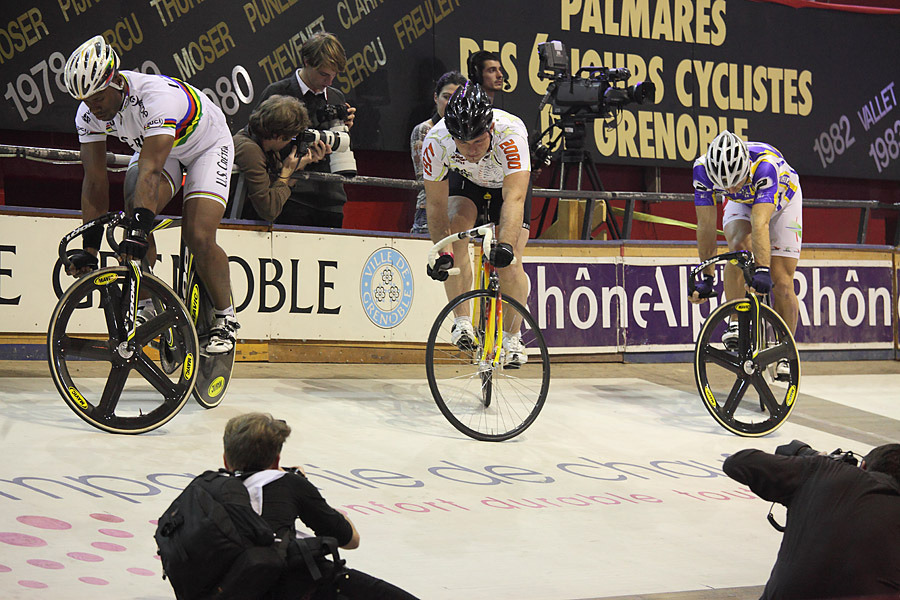 GRENOBLE SIX: TRACKSTANDERS   I love this shot from Fenlandsnapper at the Grenoble Six Day Race a few weeks ago.  The trackstanding contest lasted for 33 minutes and featured some truly legendary trackies.  Here's what Fenlandsnapper says about it:  « One of the features of the Saturday evening at the Grenoble 6 Day track event in 2011 was a track stand competition. The participants were the sprinters at the event with a guest appearance by Arnaud Tournant (center) the world trackstanding record holder (45 minutes).  After about 10 minutes, these were the three remaining riders. François Pervis (right) was the first to falter after about 20 minutes I think.  The other two lasted to 33 minutes.  Grégory Baugé (left) won by outlasting Arnaud Tournant by a minute. »  Check out the rest of Fenlandsnapper's photos and stories on Flickr.