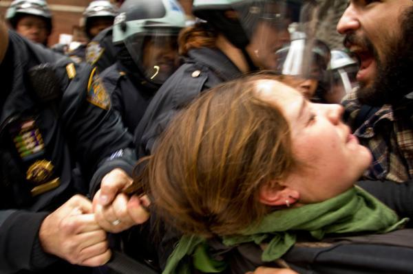 Police hurt this woman by pulling her hair. New York, New York | Nov. 18, 2011